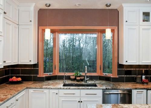 Окно с эркером в интерьере кухни фото