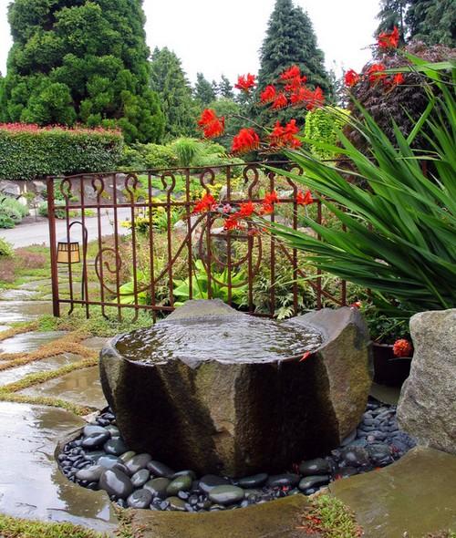 Оригинальный фонтан для сада фото