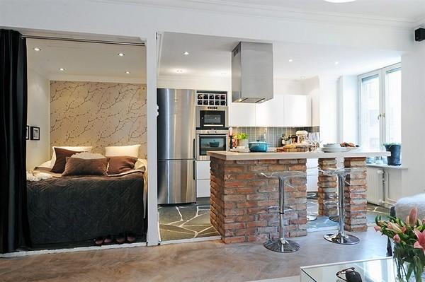 Кухня в квартире-студии с барной стойкой