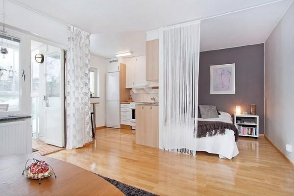 Веревочные шторы для зонирования спального места в гостиной
