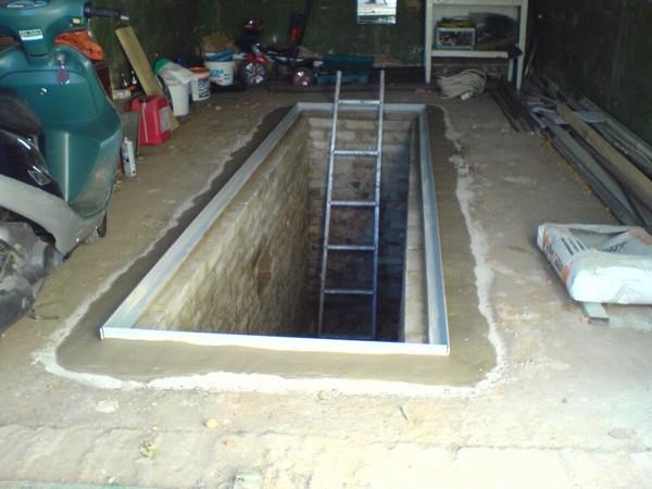 Смотровая яма обложенная кирпичом фото